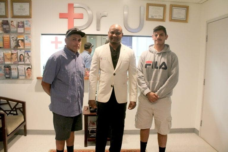 Dr. Umar with patient and his father
