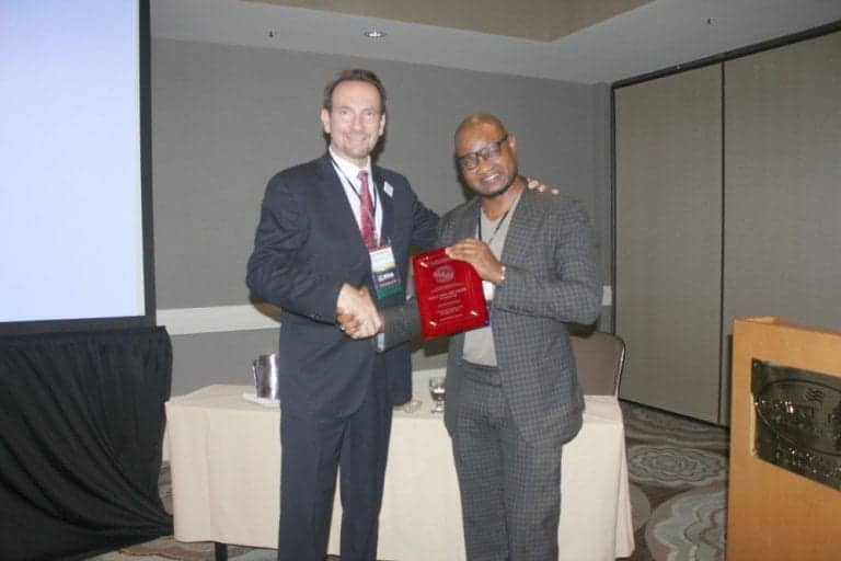The ISHRS president, Dr. Ken Washenik presents Dr. Umar an award to recognize his commitment to educational excellence at the 2017 ISHRS regional workshop in Los Angeles, CA