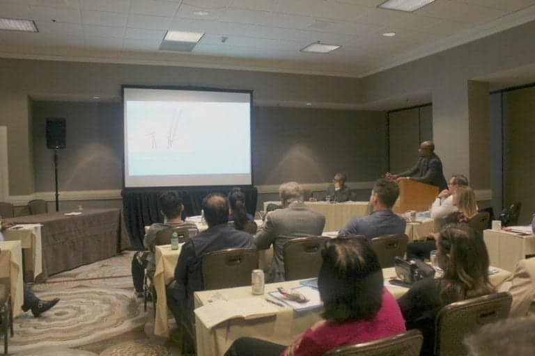 Dr. Umar giving a presentation at the ISHRS workshop on how his Dr.UGraft technology works to safely remove body hair to help patient cases that require a greater donor graft count